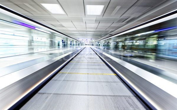 Simétrico em movimento azul escada rolante dentro contemporâneo Foto stock © cozyta