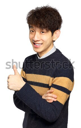 Young laughing asian man showing thumb up hand gesture Stock photo © cozyta