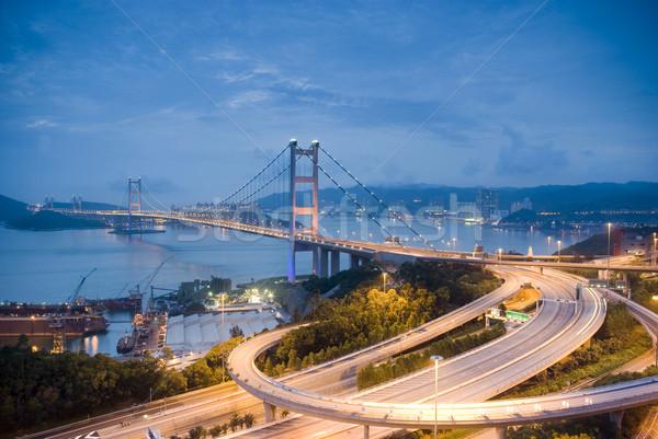 Varázslatos este Hongkong híd épület napfelkelte Stock fotó © cozyta