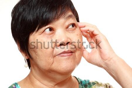 азиатских женщину глядя право счастливым волос Сток-фото © cozyta
