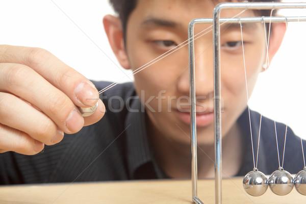man moving Newton balls in office  Stock photo © cozyta