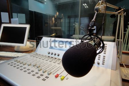 mic in front of the control panel in broadcasting studio  Stock photo © cozyta