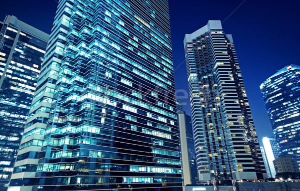 Stock photo: Tall office buildings by night
