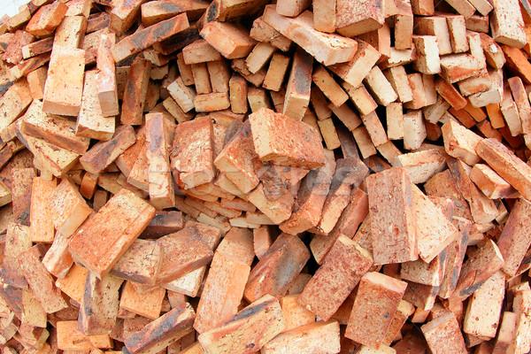 Tégla halom piros nap épület építkezés Stock fotó © cozyta