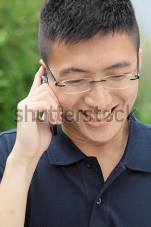 Kínai férfi beszél telefon aggodalom városi Stock fotó © cozyta