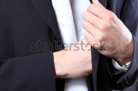 businessman hand in  pocket of a jacket  Stock photo © cozyta