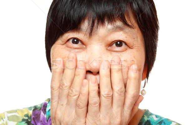 asian woman use hand cover her mouth Stock photo © cozyta