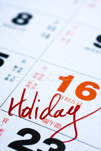 Hand writing holiday important date on calendar Stock photo © cozyta