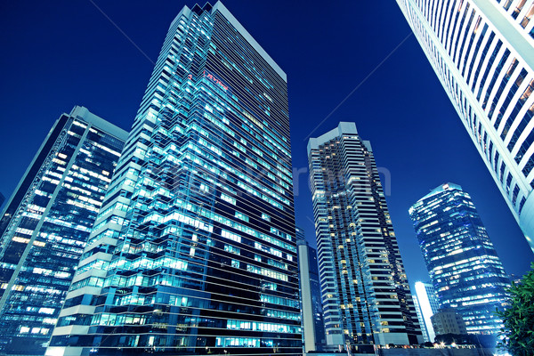 Tall office buildings by night  Stock photo © cozyta
