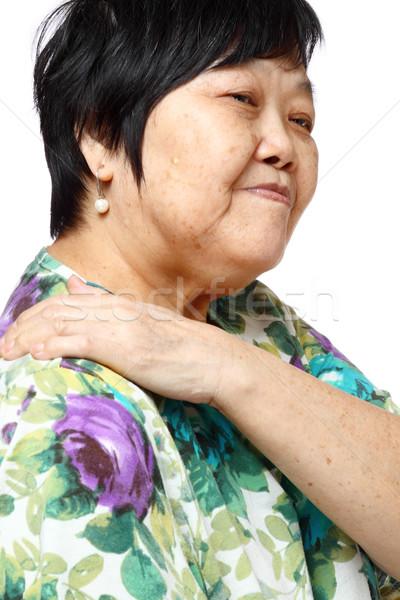 senior woman holding her aching back  Stock photo © cozyta