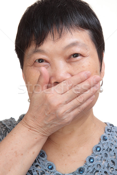 old woman covering her mouth Stock photo © cozyta