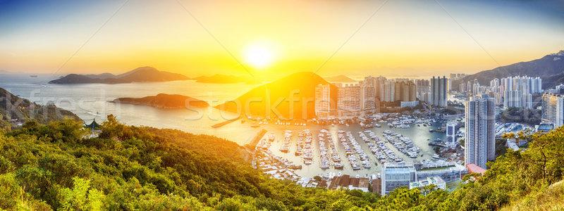Hong Kong hermosa puesta de sol oficina edificio paisaje Foto stock © cozyta