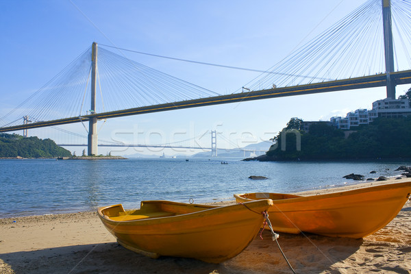 boat on the beach under the bridge Stock photo © cozyta