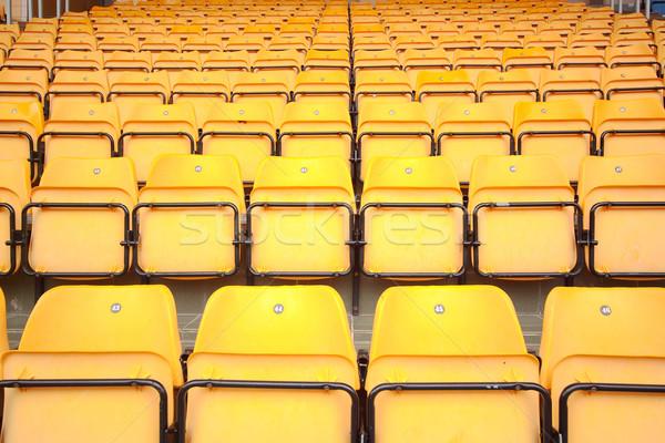 Plenty of yellow plastic seats at stadium Stock photo © cozyta