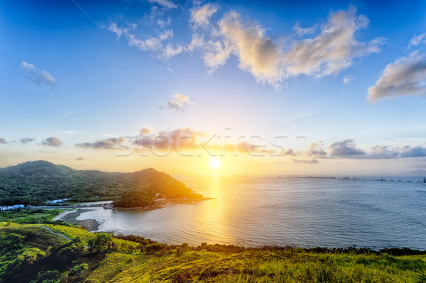 Village with beautiful sunset over hong kong coastline Stock photo © cozyta