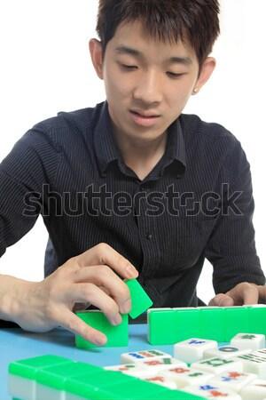 Chinese man play Mahjong, traditional China gamble.  Stock photo © cozyta