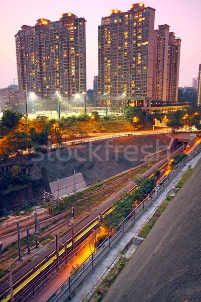 Cidade trem trilho pôr do sol momento céu Foto stock © cozyta