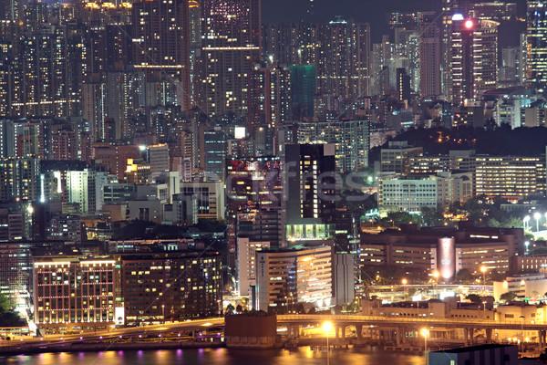 Hongkong éjszaka égbolt fa épület tájkép Stock fotó © cozyta