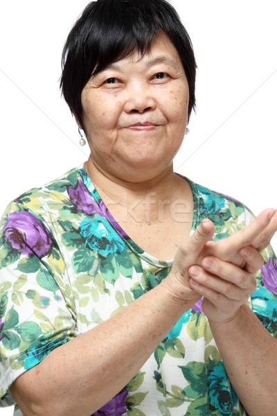 Senior woman doing a series of warm-up exercises Stock photo © cozyta