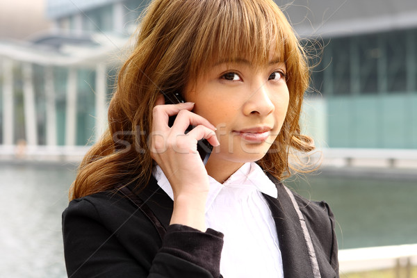 Güzel iş kadını telefon modern bina iş kız Stok fotoğraf © cozyta