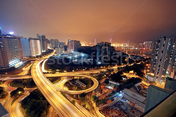 Autóút éjszaka autók fény modern város Stock fotó © cozyta