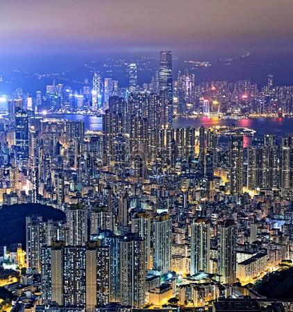Hongkong éjszaka fa épület tájkép kék Stock fotó © cozyta