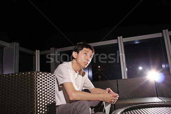 Man sit on a bench while relaxing at a pub.  Stock photo © cozyta