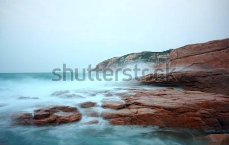rocky sea coast and blurred water in shek o,hong kong  Stock photo © cozyta