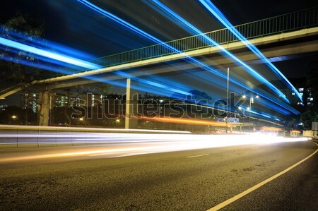 Megacity Highway at night with light trails Stock photo © cozyta