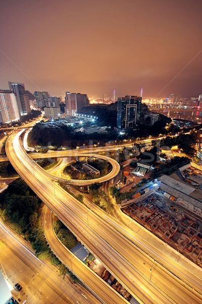 Freeway in night with cars light in modern city.  Stock photo © cozyta