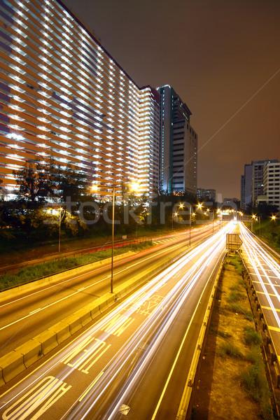 Negocios noche coche carretera edificio puesta de sol Foto stock © cozyta
