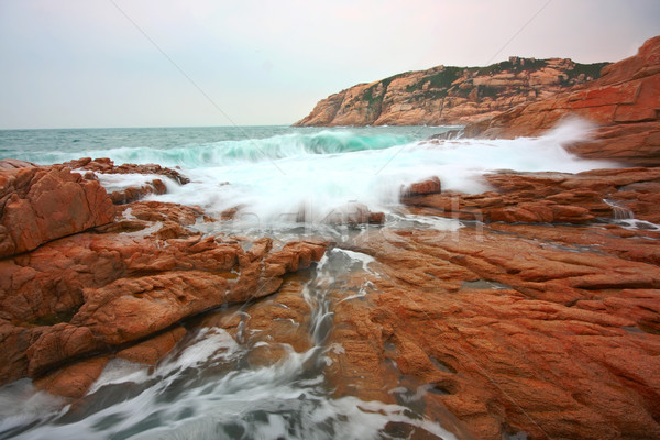 rocky sea coast and blurred water in shek o,hong kong  Stock photo © cozyta