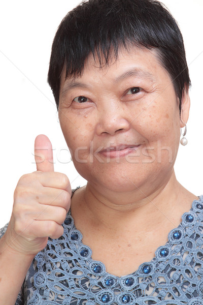 Happy Asian young woman give you an excellent gesture with frien Stock photo © cozyta