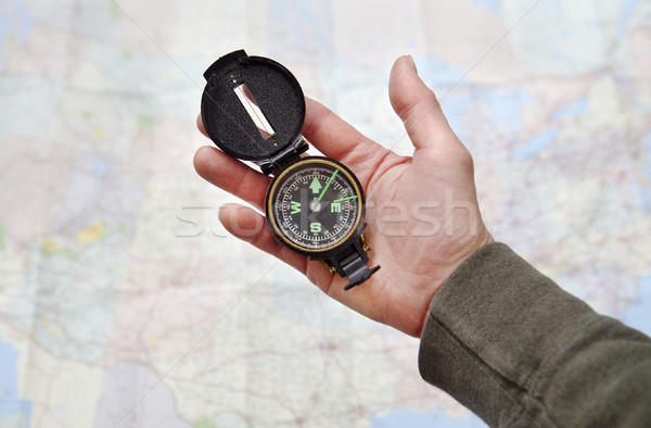 Man holding Compass Stock photo © CrackerClips