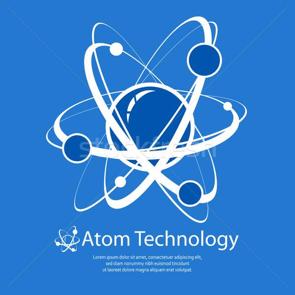 Atom on blue & text Stock photo © creatOR76