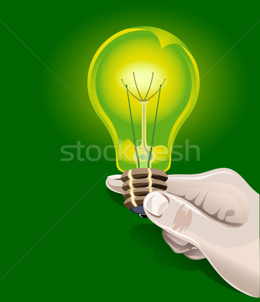Electric bulb in hand Stock photo © creatOR76
