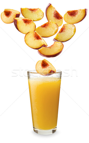 Peaches falling in peach juice Stock photo © crisp