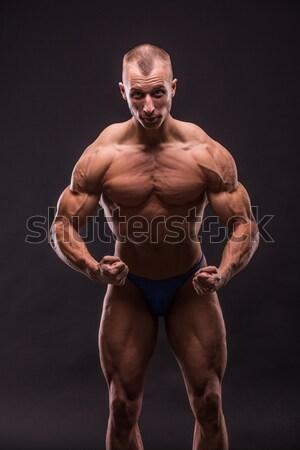 Testépítő izmok stúdió férfi szexi boldog Stock fotó © csakisti
