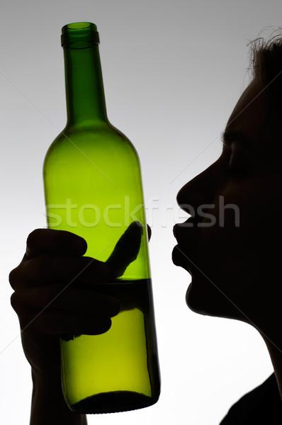 Stok fotoğraf: Kadın · öpüşme · şarap · şişesi · siluet · kız · el