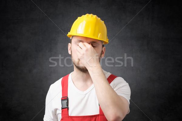Fáradt építőmunkás citromsárga védősisak kéz arc Stock fotó © CsDeli