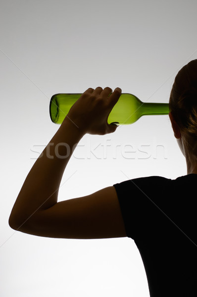 Silhouette of an alcoholic with a bottle Stock photo © CsDeli