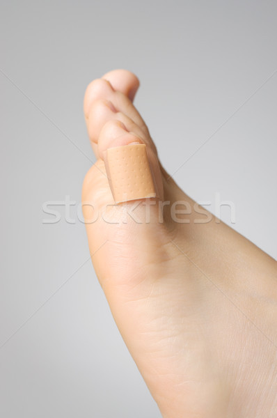 Closeup of a plaster on female toe Stock photo © CsDeli