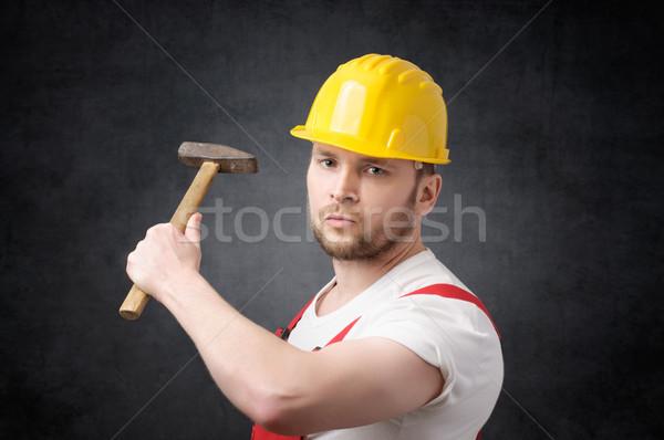 Stock fotó: építőmunkás · kalapács · mérges · kéz · férfi · építkezés