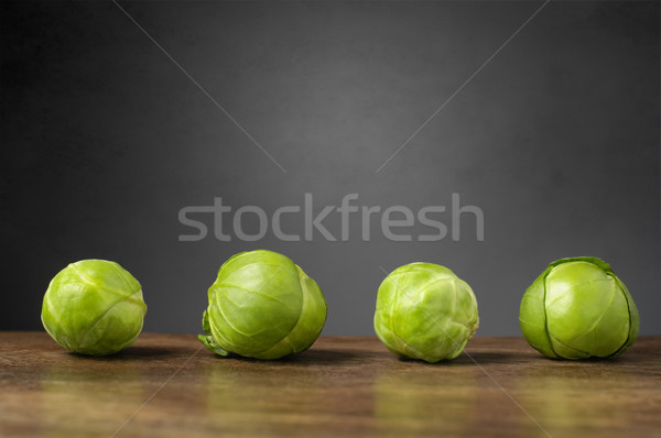 Four brussels sprouts on a row Stock photo © CsDeli