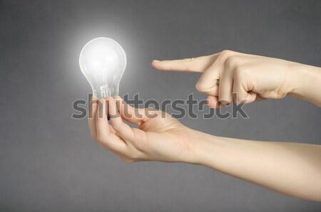 Kéz villanykörte ujj mutat izzó üzlet Stock fotó © CsDeli