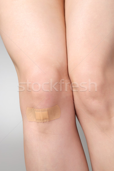 Plaster on female leg Stock photo © CsDeli