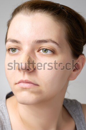 Closeup of a plaster on female nose Stock photo © CsDeli