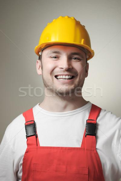 Mosolyog fiatal munkás boldog ezermester citromsárga Stock fotó © CsDeli