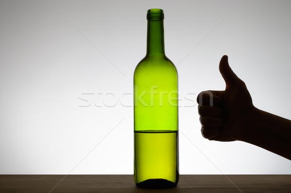 Signo botella vino silueta mano Foto stock © CsDeli