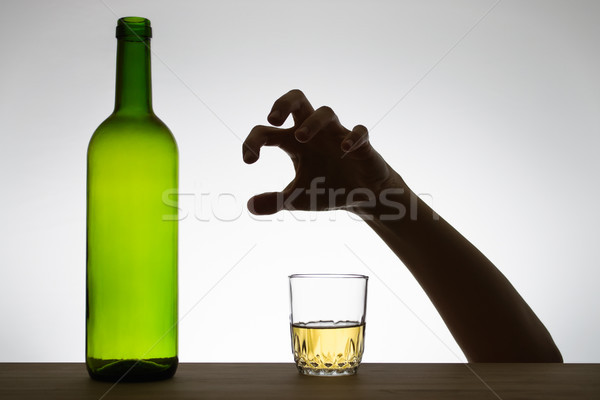 Hand reaching for a glass of wine Stock photo © CsDeli